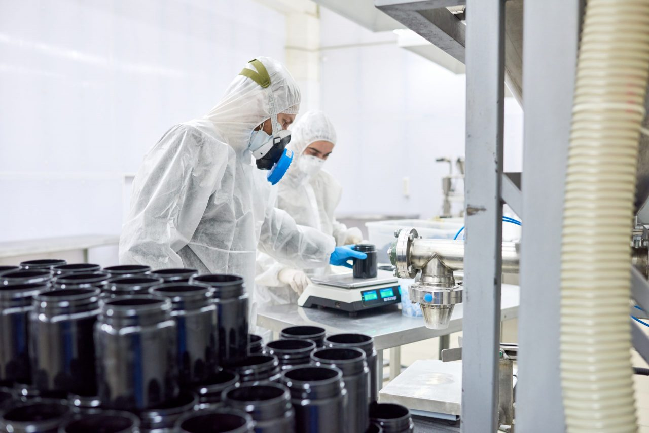pharmaceutical-plant-workers-using-scale-3E2PA4Z-scaled-1280x855.jpg